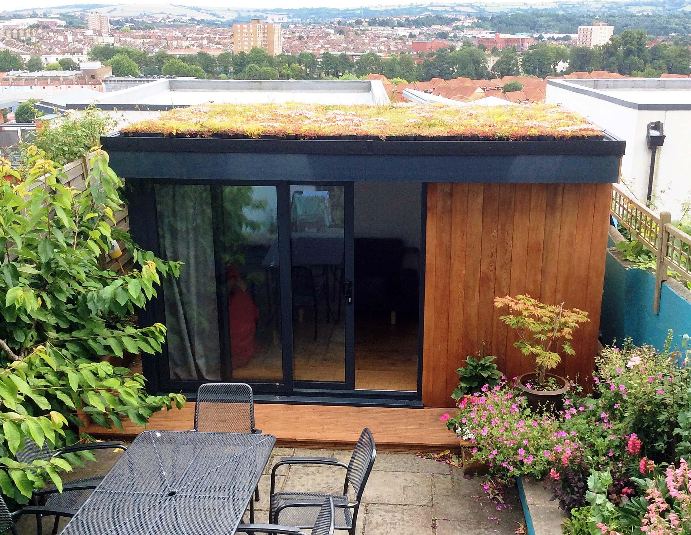 Small garden room with sedum roof