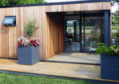 Garden living annexe with cedar cladding and deck