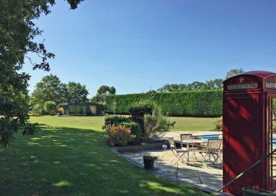 large garden with garden room