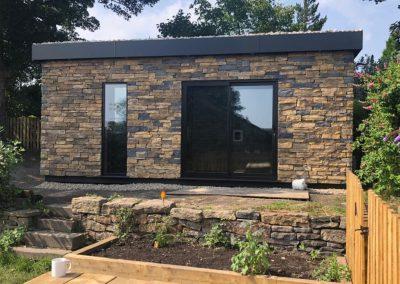 Holmfirth garden sound studio clad with stone