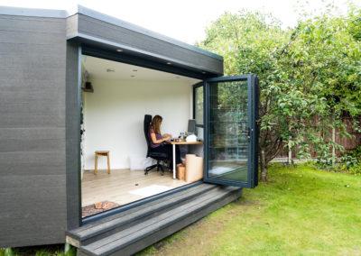 triangular garden room with person working at desk